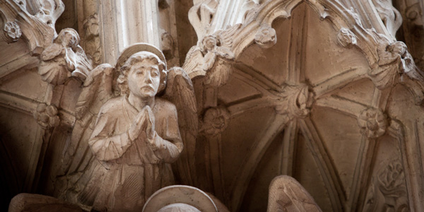 Stone angel, carved by Nathaniel Hitch, part of the reredos at All Saints Hove